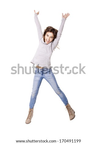 Little girl jumping over a white background - stock photo