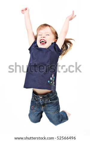 little girl jumps on a white - stock photo