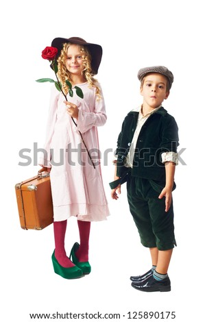 little girl keep red rose and vintage suitcase and cute little boy isolated on white background - stock photo