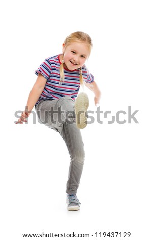 Little girl kick by foot. Studio shot.