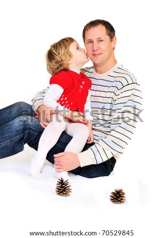 little girl kissing father's cheek - stock photo