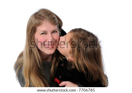 Little girl kissing mother isolated over a white background.
