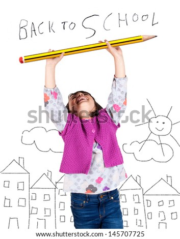 Little girl laughing with arms up holding a big pencil. Drawing of a city in the background. Back to school concept. - stock photo
