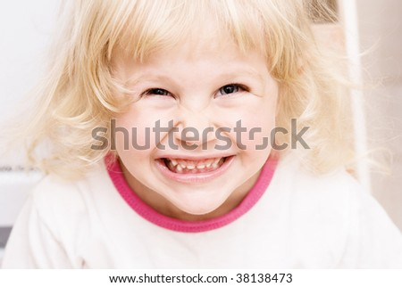 Little girl laughs and pleases - stock photo