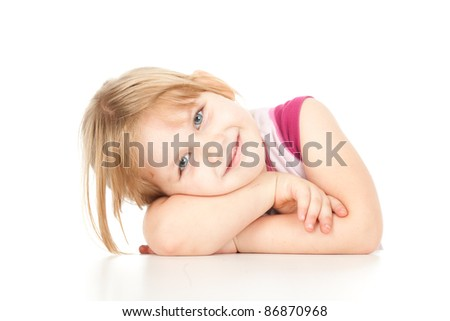 little girl leaning on table, white background - stock photo