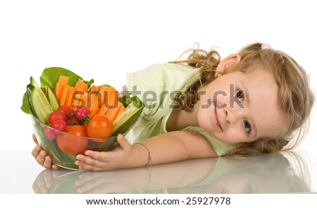 Little girl leaning on the table with a bowl of vegetables - isolated - stock photo