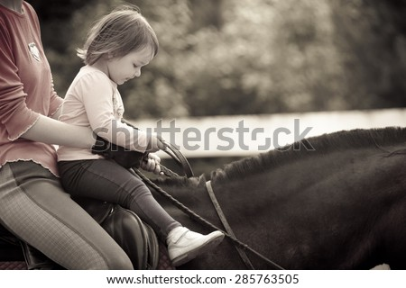 Little girl Learning horseback riding