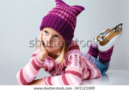 Little girl learning to ice-skate. Winter fun. - stock photo