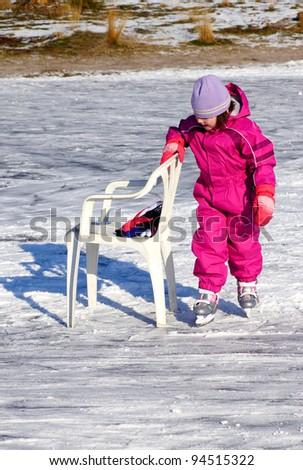 Little girl learning to skate - stock photo