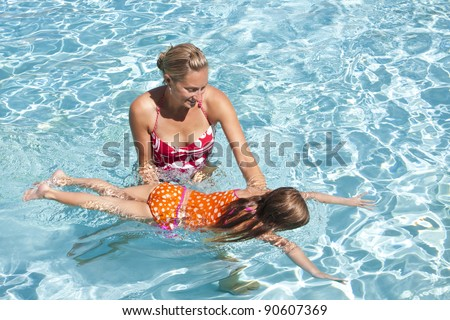 Little Girl learning to swim - stock photo