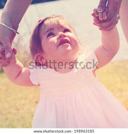 Little girl learning to walk - instagram effect - stock photo