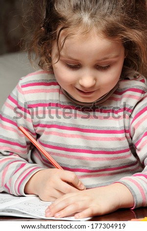 Little girl learning to write their own - stock photo