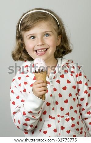 Little girl licking icecream - stock photo