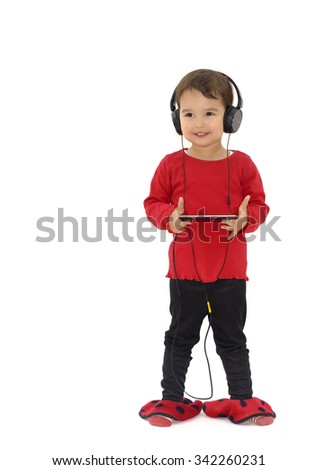 Little girl listening music with headphones, isolated on white - stock photo