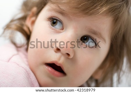 little girl looking over shoulder, with open mouth