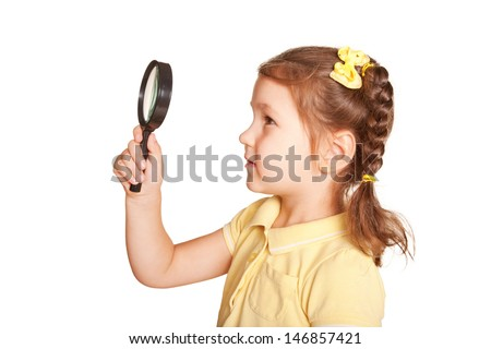 Little girl looking through a magnifying glass carefully, ready for your text, logo or symbols.. Side view. Isolated on white background