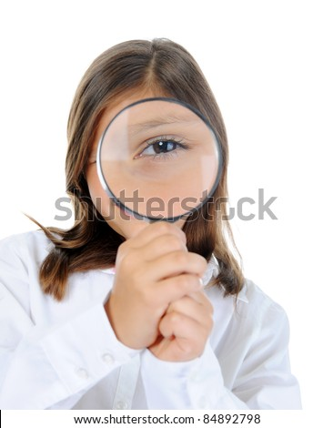little girl looking through a magnifying glass isolated on a white background