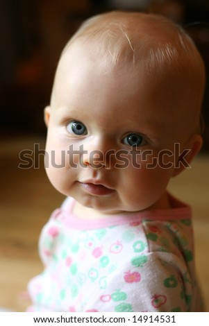 little girl looking with an innocent expression - stock photo