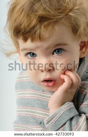 little girl looking  with open mouth - stock photo