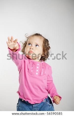 little girl looks up - stock photo