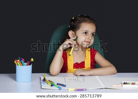 Little girl lost in thoughts - stock photo