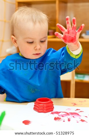 Little girl make a finger paint - stock photo