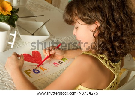 Little girl making a drawing for mother's day - stock photo