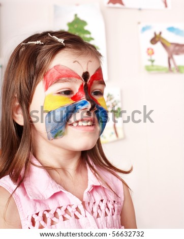 Little girl  making face painting. - stock photo