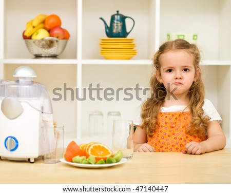 Little girl making faces asking - fruit juice again and no junk food ? - stock photo