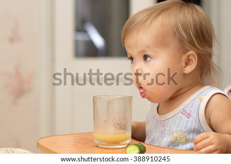 Little girl making funny face while eating - stock photo