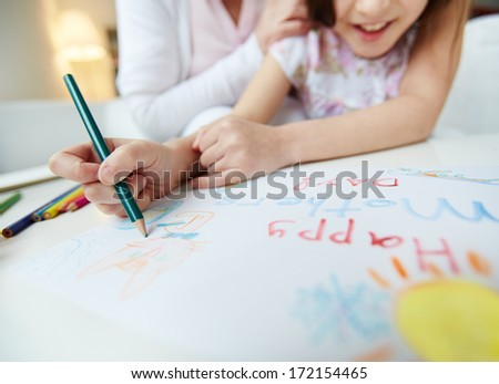 Little girl making greeting card for her mom on mother�¢??s day - stock photo