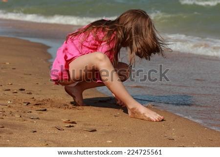 Little girl near the  sea - stock photo