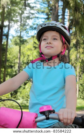 Little girl on a bicycle - stock photo