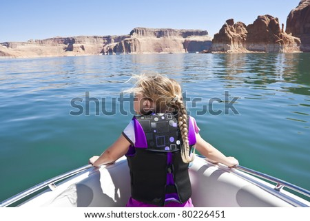 Little Girl on a boat ride at Lake Powell - stock photo
