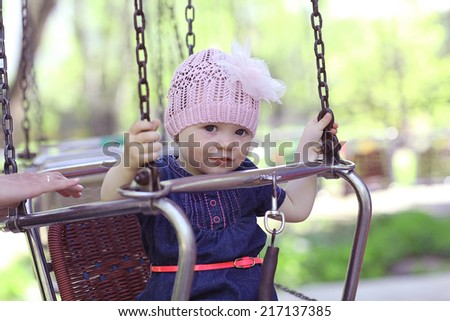 Little girl on a carousel - stock photo