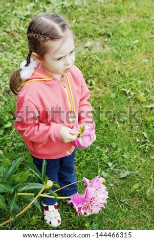 Little girl on a lawn - stock photo