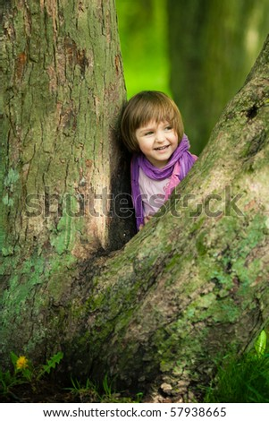 little girl on big tree - stock photo