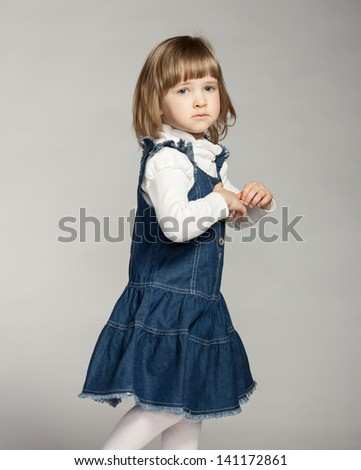 Little girl on dark background