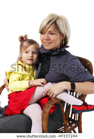 Little girl on hands for a young mother in a wicker chair on the white background