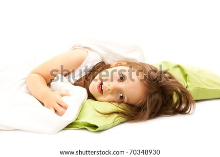 little girl on her bed early in the morning - stock photo