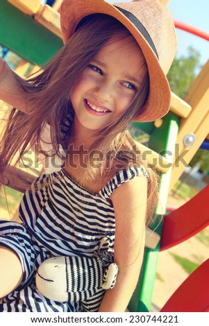 little girl on outdoor playground equipment - stock photo
