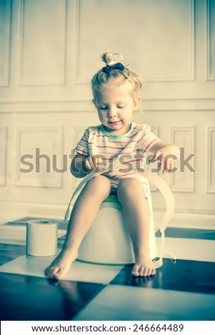 Little girl on potty - stock photo
