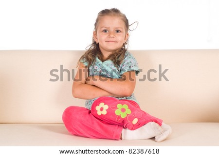little girl on sofa on a white