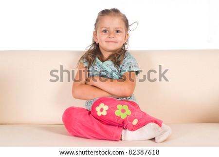 little girl on sofa on a white - stock photo