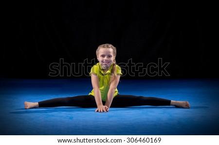 Little girl on sport mat - stock photo