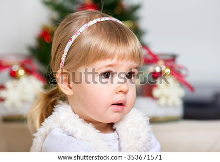 Little girl on the background of the Christmas tree