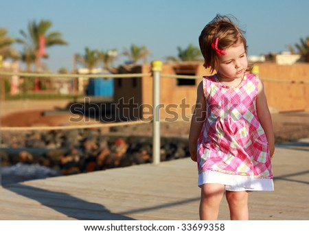 Little Girl On The Beach - stock photo