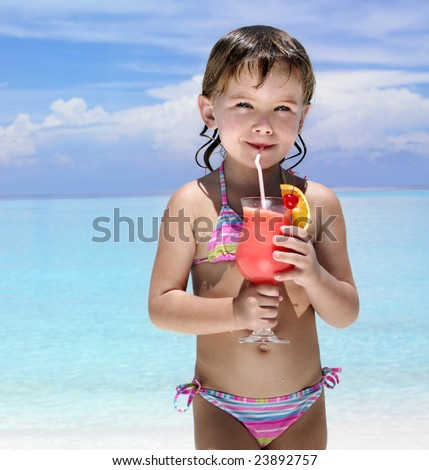 little girl on the beach drinking exotic cocktail, sea, ocean, bikini, summer, tropical, outdoors, looking at camera
