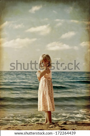 little girl on the beach. stylized old photo  - stock photo