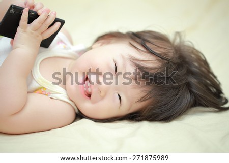 Little girl on the bed - stock photo